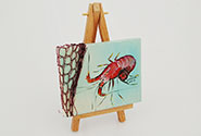 mini easel with prawn painting