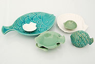 various designs of fish and shells serving plates
